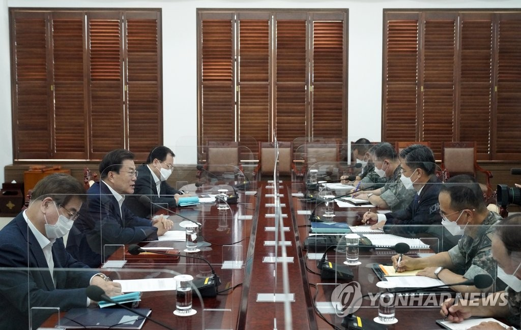 President Moon Jae-in (2nd from L) speaks during a meeting with South Korea's top military leaders at Cheong Wa Dae in Seoul on Aug. 4, 2021, in this photo provided by his office. (PHOTO NOT FOR SALE) (Yonhap)