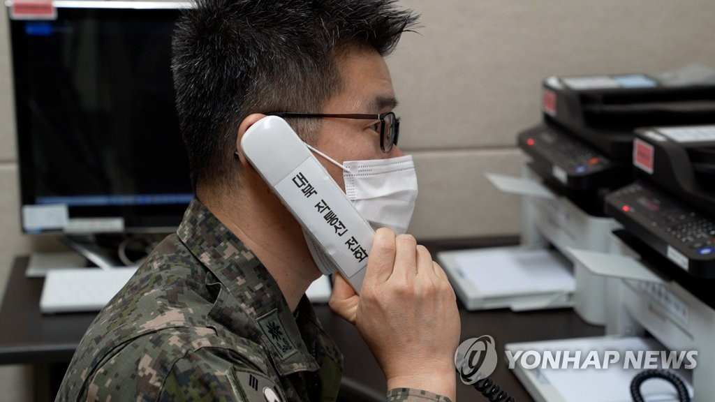 A South Korean officer makes a test call with North Korea via a hotline set up between the militaries of the two Koreas on Oct. 4, 2021, in this photo provided by the defense ministry. The Koreas restored their direct communication lines on the same day after 55 days of suspension. (PHOTO NOT FOR SALE) (Yonhap)